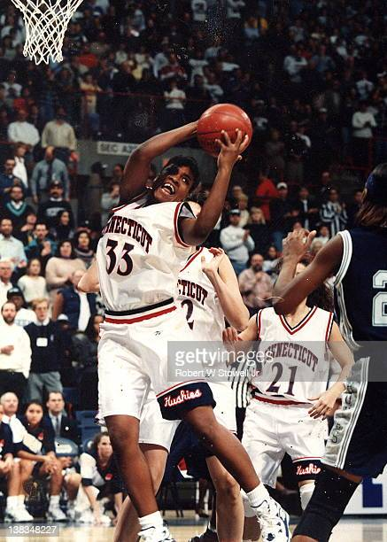 American basketball player Jamelle Elliott of the University of Connecticut with the ball during a game against Georgetown University, Storrs,...