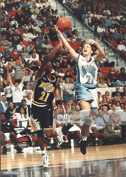 American basketball player Jennifer Rizzotti of the University of Connecticut with the ball during an exhibition game against Colorado Explosion...