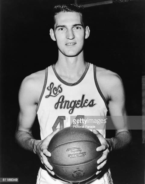 American basketball player Jerry West poses in a Los Angeles Lakers uniform and holds a basketball in his hands 1960s