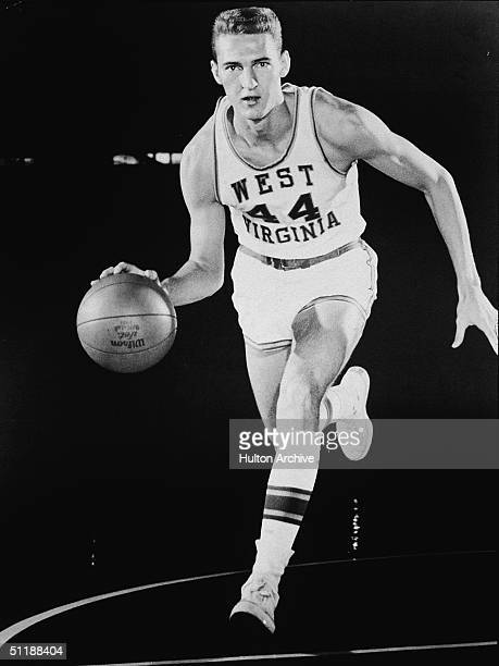 American basketball player Jerry West University of West Virginia runs and dribbles with a basketball 1950s