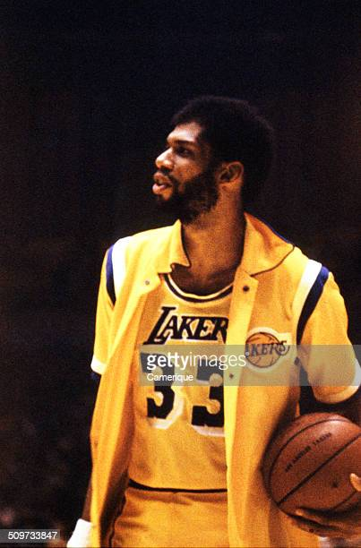 American basketball player Kareem Abdul Jabbar of the Los Angeles Lakers stands with the ball under his arm September 1982