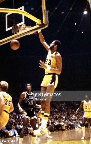 American basketball player Kareem Abdul Jabbar of the Los Angeles Lakers dunks the ball against the San Antonio Spurs September 1982