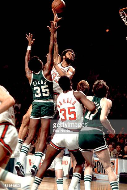 American basketball player Kareem Abduljabbar of the Milwaukee Bucks tips the ball towards the basket in a game against the Boston Celtics Milwaukee...