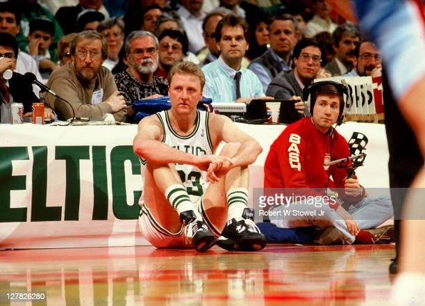 American basketball player Larry Bird, of the Boston Celtics, sits on the sidelines in front of the scorer's table during a game, Hartford,...
