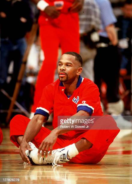American basketball player Michael Adams of the Washington Bullets stretches before a game against the Boston Celtics Hartford Connecticut 1991