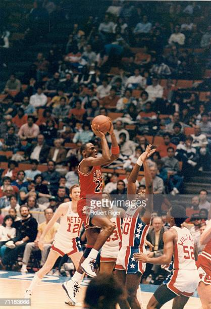 American basketball player Michael Jordan of the Chicago Bulls jumps for a shot during a game against the New Jersey Nets at the Meadowlands Arena...