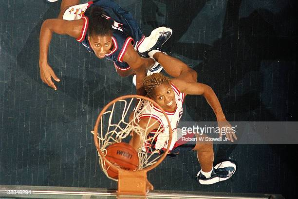 American basketball player Nikki McCray watches for the rebound during the first American Basketball League All-Star game, Hartford, Connecticut,...