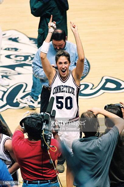 American basketball player Rebecca Lobo of the University of Connecticut celebrates after winning the East Regional vs Virginia at Gampel Pavilion...