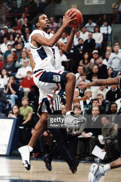 American basketball player Richard Hamilton of the University of Connecticut with the ball during a game against Georgetown University Storrs...
