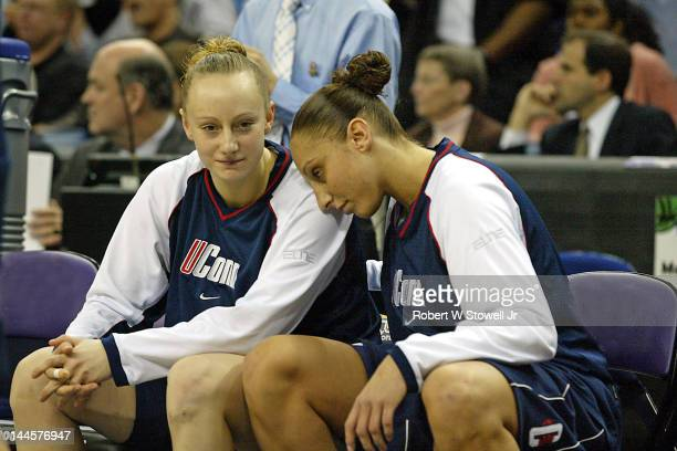 American basketball players Maria Conlon and Diana Taurasi both of the University of Connecticut sit together on the bench prior to the to the 2004...