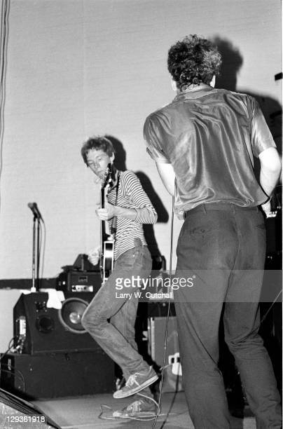 American bass player Mike Mills and singer Michael Stipe of the group REM perform during a free concert in the student center at the University of...