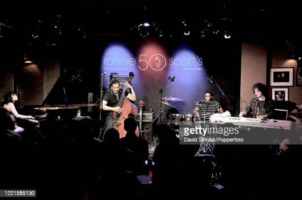 American bassist Stanley Clarke performs live on stage with his band at Ronnie Scott's Jazz Club in Soho, London on 14th July 2010.