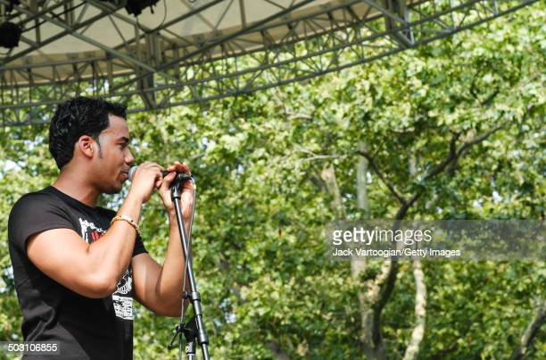 American Batchata singer Anthony 'Romeo' Santos performs with his band Aventuraat Central Park SummerStage New York New York August 2 2003