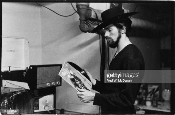 American beat poet and manager of Cafe Rafio Ronald Von Ehmsen removes a record from its sleeve as he stands in his basement apartment New York May...