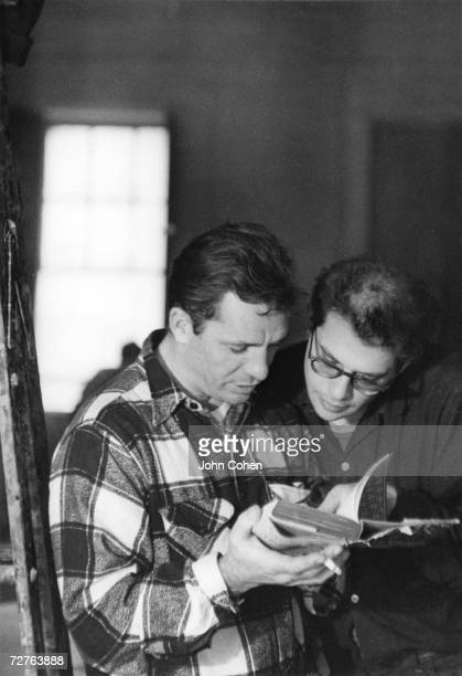 American beat writers Jack Kerouac and Allen Ginsberg read a book together 1959 Kerouac holds a cigarette in one hand