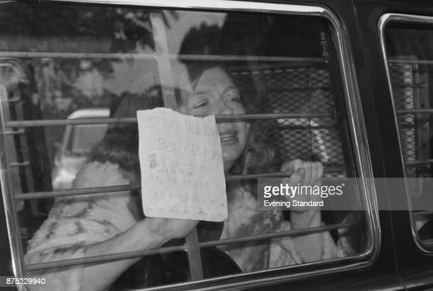 American beauty queen Joyce McKinney holding a message against the barred window of the police van She and Keith May are accused of kidnapping the...