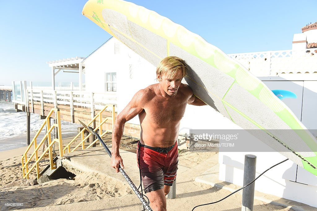 American big-wave surfer Laird Hamilton exits the beach during huge swells generated by hurricane Marie Reach along the the southern California coastline on August 27, 2014 in Malibu, California.