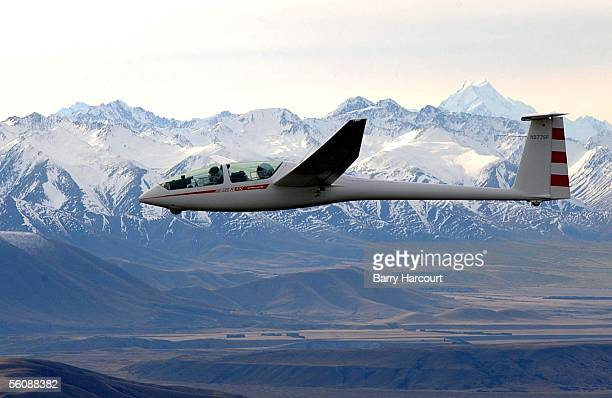 American billionare and adventurer Steve Fossett with his copilot Einar Enevoldson take in magnificent views of the Southern alps and Mt Cook as they...