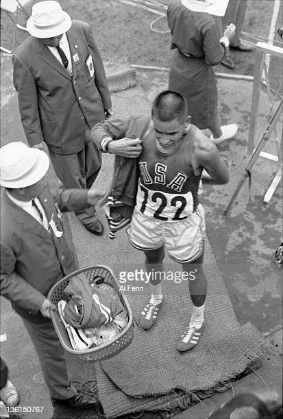 American Billy Mills celebrating winning the gold medal in the 10000 meter race at the Summer Olympics Tokyo Japan 1964