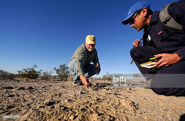 American biologist and entrepreneur Craig Venter left and Gerardo Toledo collect rock material at Mojave National Preserve Venter wants to try and...