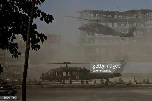 American Black Hawk Helicopters swoop in to a roundabout in western Kabul to collect a New Zealand SAS soldier, Corporal Doug Grant, mortally wounded...