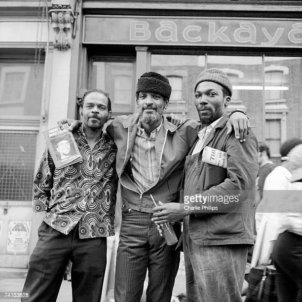 American Black Panther Party member Hakim Jamal , on the Portobello Road, London, 1971. Jamal is holding a copy of his book 'From the Dead Level:...