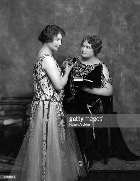 American blind deaf mute authoress Helen Adams Keller with Anne Sullivan Mrs Macy her interpreter