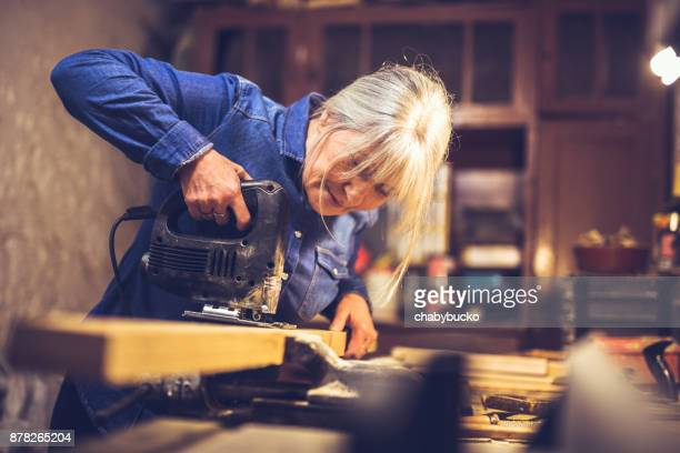american blue collar worker in a workshop - carving craft product stock pictures, royalty-free photos & images