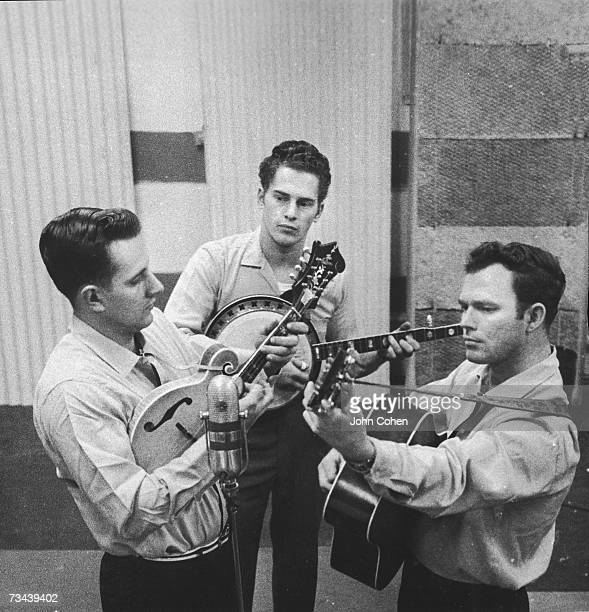 American bluegrass band The Country Gentlemen left to right John Duffey on mandolin Eddie Adcock on banjo and Charlie Waller on guitar play their...