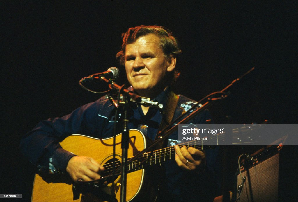 American bluegrass musician Doc Watson performing at a concert at the Gaumont, Kilburn, London, 10th November 1977. He was performing with his son Merle (1949 - 1985).