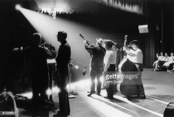 American bluegrass musician Earl Scruggs and his band play onstage at Ryman Auditorium during a performan on the Grand Ol Opry, Nashville, Tennessee,...