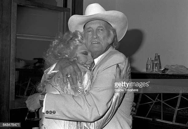 American bluegrass musician singer and songwriter Bill Monroe embracing a fan backstage at The Old Town School of Folk Music in Chicago Illinois USA...