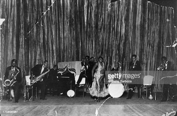 American blues and jazz vocalist Bessie Smith performs on stage with her band, Philadelphia, Pennsylvania, early twentieth century.