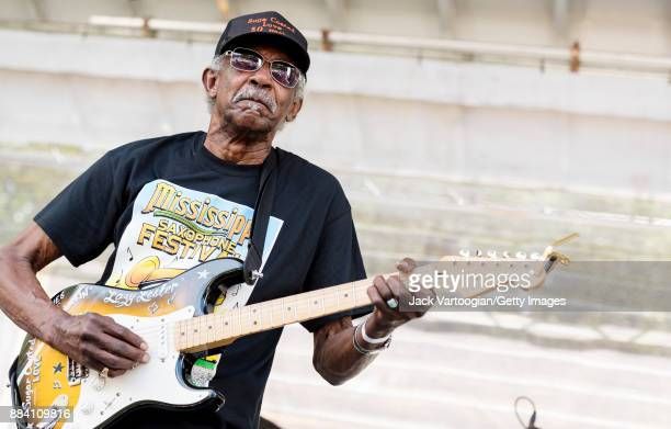 American Blues and RB musician Lazy Lester plays guitar as he performs with the Rockin' Johnny Band on the Front Porch Stage at the 33rd Annual...