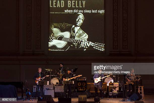 American Blues and Rock musician Walter Trout plays guitar with unidentified others onstage during Lead Belly Fest at Carnegie Hall New York New York...