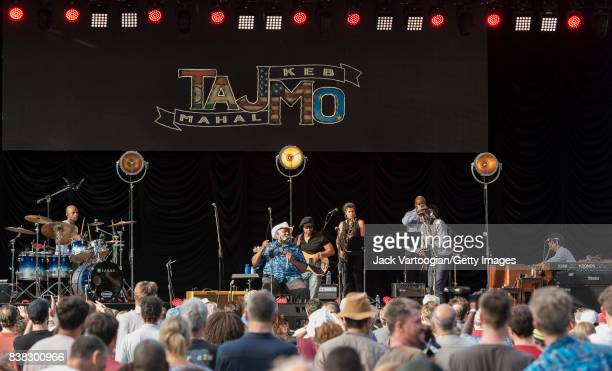 American Blues group TajMo performs at Central Park SummerStage New York New York August 13 2017 Pictured are from left Marcus Finnie on drums...