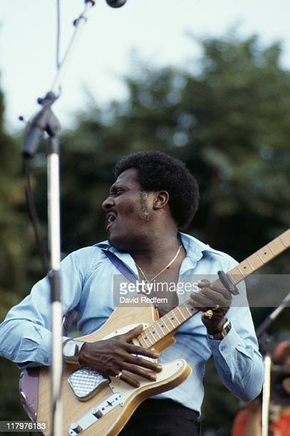 Albert Collins US blues guitarist and singer playing the guitar on stage during a live concert performance circa 1983