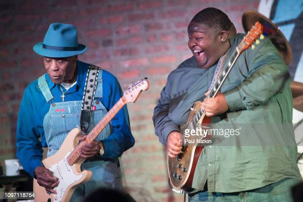 American blues guitarists Buddy Guy left and Christone 'Kingfish' Ingram perform on stage at Buddy Guy's Legends in Chicago Illinois January 18 2019