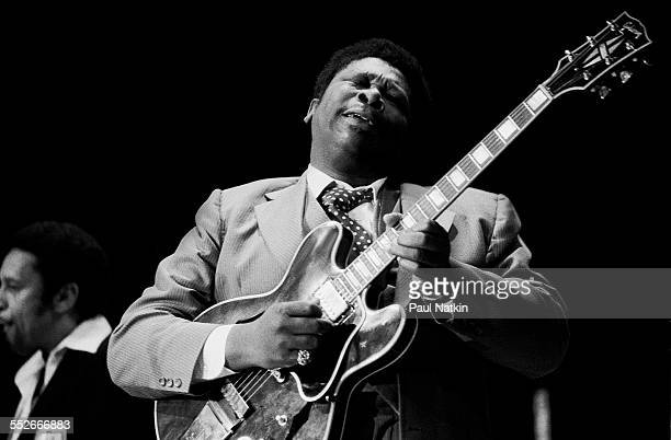 American Blues musician BB King plays guitar as he performs onstage early 1990s