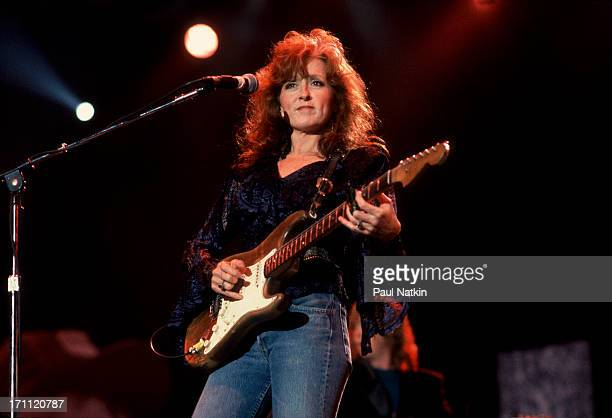 American blues musician Bonnie Raitt performs onstage at Farm Aid in the Hoosier Dome Indianapolis Indiana April 7 1990