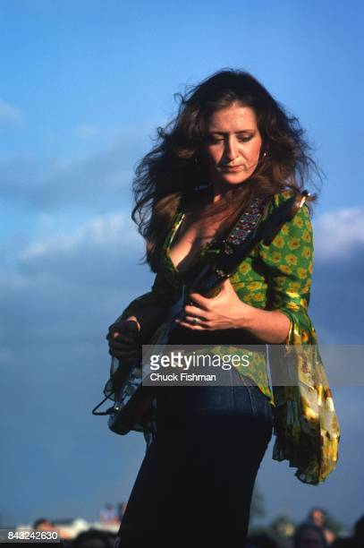 American Blues musician Bonnie Raitt plays guitar as she performs onstage during the New Orleans Jazz and Heritage Festival New Orleans Louisiana...