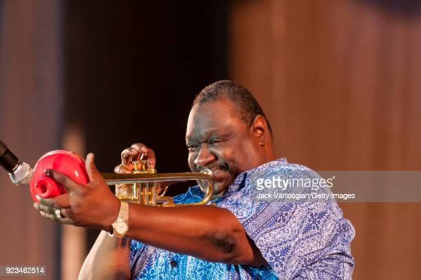 American Blues musician James 'Boogaloo' Bolden plays trumpet as he leads the BB King Orchestra on Grant Park's Petrillo Music Shell stage during the...