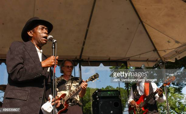 American Blues musician John 'The Iceman' Brim performs with the Chicago Blues All Stars on the Crossroads Stage at the 19th Annual Chicago Blues...