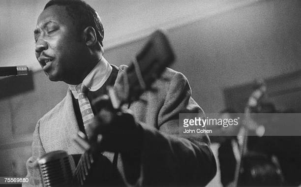 American blues musician Muddy Waters plays the guitar in New York New York 1959