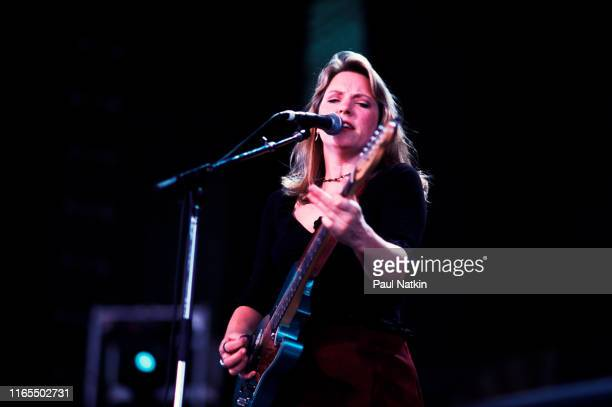 American Blues musician Susan Tedeschi plays guitar as she performs onstage during the Farm Aid benefit concert Mannasas Virginia September 12 1999