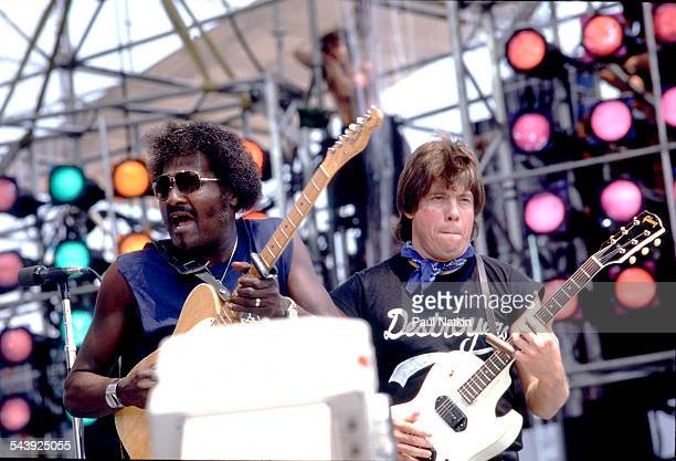 American blues musicians Albert Collins and George Thorogood perform on stage during the Live Aid Concert at Veterans Stadium at JFK Stadium...