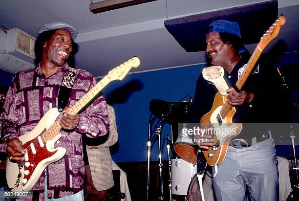American Blues musicians Buddy Guy and Albert Collins perform on stage at Buddy Guy's Legends nightclub Chicago Illinois January 1985