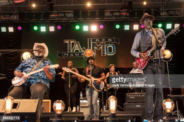 American Blues musicians Taj Mahal on banjo and Keb' Mo' on guitar lead their group TajMo during a performance onstage at Central Park SummerStage...