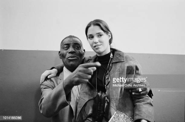 American blues singer and musician Howlin' Wolf born Chester Arthur Burnett with Chess Records/Janus publicist Linda Solomon sitting on his lap circa...