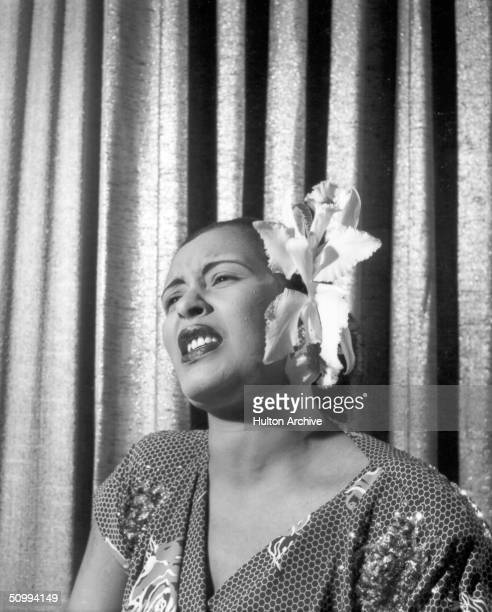 American blues singer Billie Holiday singing with an orchid in her hair early 1950s
